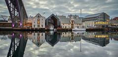 Haugesund, Norway (Vest der ute) Tags: xt2 norway rogaland haugesund sky sea seaside city clouds buildings boathouse boat sailboat reflections bridge crane fav25