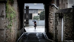 Lannilis, raining Sunday (patrick_milan) Tags: lannilis omgrella rain sunday street
