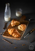 Freshly baked croissants on wooden cutting board with milk (Food photography / Food styling) Tags: dough gold pastry background baked bakery bread breakfast brown brunch crispy croissant food french milk snack twisted