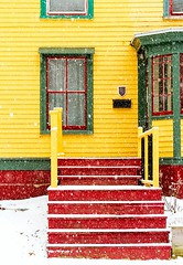 Red Steps (Karen_Chappell) Tags: red yellow green steps snow snowy snowing city urban house home paint painted wood wooden clapboard downtown stjohns avalonpeninsula atlanticcanada canada newfoundland jellybeanrow nfld weather winter window rowhouse