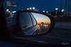 San Antonio in my Rear View Mirror (Andrea Garza ~) Tags: sanantonio texas rearview mirror sunset tx city lights i35 ihatei35 familyday i♥myfamily 50mm 50 niftyfifty car road headlight