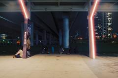 Laser Beams (OzGFK) Tags: 35mm asia cinestill cinestill800t cinestillfilm jem jemmall jurongeast jurongeastmall nikkor nikon singapore analog film longexposure night streetphotography urban mrt trainstation laser halation neon people waiting