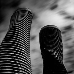 Absolute 2 (aT0Mx) Tags: building tower black white architecture clouds longexposure reflection cityscape landscape long exposure big stopper polariser tall perspective city construction lines shapes mono bw monochrome skyscraper sky toronto absolute towers ranger cokin 10stop 30sec pentax pentaxlens pentaxart ontario canada mississauga pentaxsmc geometric highrise 70absoluteave polarizer