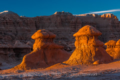 Sandstone Hoodoos In Goblin Valley State Park (Lee Rentz) Tags: april entradasandstone goblinvalley goblinvalleystatepark hanksville jurassic sanrafaeldesert sanrafaelswell alien america color early eroded erosion firstlight formation formations geologic geological geology glow goblins hoodoo hoodoos landscape light morning mushroomshaped natural nature northamerica orange park planet sandstone shape shapes southwest southwestern spring statepark strange sunrise us usa utah valley weathered weird wild