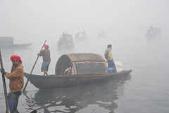 Winter Season in Bangladesh.. (sajjadnayan) Tags: narayanganj bangladesh river boat fog people color bondar environment oarsman navigation naturewater winter weather boatman change changes climatecountry day morning movement outside seasonal transport transportation world asia asian southasia subcontinent indiansubcontinent man men women woman worker laborer workman port seaport climatechange garment line road light car cold colorful