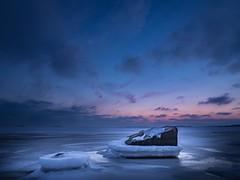 Twilight on the rocks - Explore (Jarno Nurminen) Tags: lauttasaari helsinki finland frozen rocks snow ice north balticsea seascape shore sunset twilight