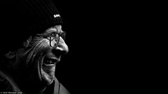 'Snake Venom' (Neil. Moralee) Tags: neilmoralee man face portrait close profile gurn gurning beer drinker hat cap black white blackbackground neil moralee nikon d7200 smirk smile teeth old mature grimace snakevenom strongest british uk alcohol strong potent mono monochrome blackandwhite bw bandw glasses side lookingright frown scowl brewer brewery brewmeister scotlandneil candid street