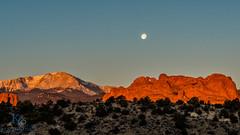 Garden of the Gods Moonset (kencphoto) Tags: colorado coloradosprings gardenofthegods moon moonset pikespeak rocks sunrise trees dramatic dynamic