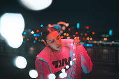 Illuminated in the light (BrianBett) Tags: portrait fairy lights pink red blue night bokeh nike film
