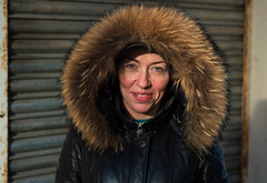 Marcy (Charles Hamilton Photography) Tags: peopleinthecity glasgowcharacterstudies facesinglasgow glasgow glasgowstreetportrait characterstudy colourstreetportrait trongate wintersun hood eyecontact backstreet naturallight primelens face smile stranger blueeyes glasgowstreetphotography nikond750 charleshamilton