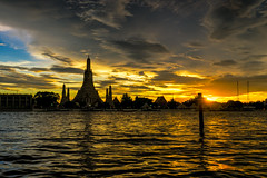 Wat Arun Temple in bangkok thailand at sunset . (MongkolChuewong) Tags: ancient architecture arun asia attraction background bangkok beautiful blue boat buddhism buildings chao chedi city cityscape culture day dusk famous holiday landmark night orange oriental phraya popular religion religious river sky skyline southeast spirituality stupa sunset temple thai thailand tourism tower traditional travel traveler traveller twilight vacations wat water