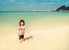 Little Girl In Okinawa (Stuck in Customs) Tags: japan okinawa rcmemories 80stays stuckincustoms stuckincustomscom treyratcliff hdr hdrtutorial hdrphotography hdrphoto aurorahdr portrait girl sea water sand sky ocean hasselblad x1d