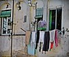 Laying clothes (Domènec Ventosa) Tags: ropa tendedero tendido persianas fachada edificio clothes line lying blinds facade building