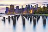 Manhattan Skyline (mpelleymounter) Tags: city newyork manhattan brooklynbridgepark pilings eastriver sunset citylights oneworldtower freedomtower wtc worldtradecentre markpelleymounter wwwphotomarkscouk pier pierpilings lowermanhattan architecture skyscraper skyscrapers buildings