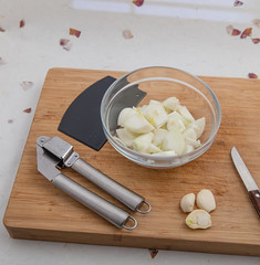 Onions, garlic, garlic press, scraper and knife. (annick vanderschelden) Tags: onion cultivar skin whiteflesh sweet flavor raw cook food decoration salad flavonoids kitchen cooking ingredient chopped vegetable bulb bulbonion common commononion allium layers pungent chemicalsubstances irritating culinary water carbohydrates flavour taste phytochemical polyphenols flavonoid enzymes alliinases bowl scraper garlicpress peelingknife belgium