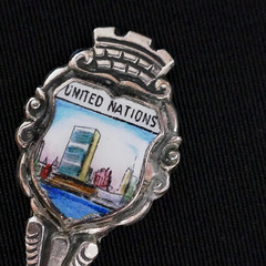 United Nations spoon (Monceau) Tags: unitednations silver spoon painting enamel small vintage lessthananinch macromondays macro souvenir