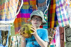 The Ultimate Tropical Tourist (aaronrhawkins) Tags: tulum market bright coconut tourist boy child children sip hat tropic tropical mexico yucatan peninsula rivieramaya mayanriviera color vacation joshua visit drink aaronhawkins