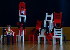 Take a seat, please...(explore) (Raquel Borrrero) Tags: smileonsaturday stacked chairs red white black playmobil toys nikon explore rojo negro sillas juego juguete