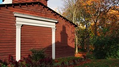 Colborne Lodge barn, 1927 - High Park, Toronto. (edk7) Tags: olympuspenliteepl5 edk7 2016 canada ontario toronto highpark colbornelodge barn architecture building oldstructure clapboard fall autumn colour tree lawn afternoon openairmuseum shadow engagedwoodcolumn engagedwoodlintel