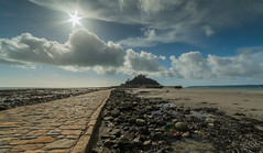 St Michaels Mount. (Go placidly amidst the noise and haste...) Tags: stmichaelsmount southwest westcountry contrejour intothelight causeway path clouds seaweed sun sunburst starburst