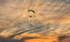 Enjoying The Sunset (http://fineartamerica.com/profiles/robert-bales.ht) Tags: arizona events facebook foothills forupload haybales howlingatmoon people photo photouploads places projects states sky extreme motorized hang glider adventure air gliding vehicle fun danger moving airplane pilot wing activity sport sail hobbies engine motor flying leisure parachute glide aircraft wind propeller horizontal hanggliding paraglider paramotor sports aviation altitude powered person recreational propelling hanggliders hobby sunset sundown airborne robertbales yellow orange yuma hangglider southwest silhouette