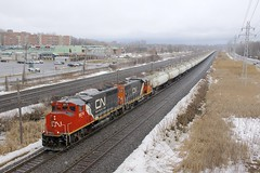 Clean EMD power (Michael Berry Railfan) Tags: cn canadiannational tanktrain cn585 unittrain fueltrain pointeclaire montreal quebec kingstonsub winter emd gmd gp402lw gp402 gp382 cn9574 cn4729