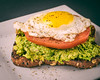 Avocado Toast with Sliced tomator and sunny side up fried egg. (Southern New England Photography) Tags: yolk eating overeasy tomato domestickitchen seasoned foodportfolio heirloomtomato objects eggs snack bounty brunch food guacamole lifestyle lively savory appetizing isolated freshness green meal fruit eaten blackbackground detail colorful crispy aromatic color clean joy plate ripe organic breakfast diet delicious bread healthy red garden freshvegetables sunnysideup nutrition heirloom ingredient avocado sandwich readytoeat lunch toast stilllife fresh yellow friedegg white