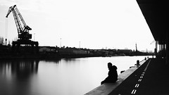 along the canal (frax[be]) Tags: streetphotography street atmosphere water dock fuji xe3 rokkor 28mm industrial outdoor highcontrast monochrome noiretblanc noir silhouette dark blackandwhite bnw bw composition