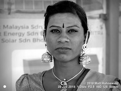 2014-05a Ambiguity 2018 (33a) (Matt Hahnewald) Tags: matthahnewaldphotography facingtheworld character head face forehead tilaka thirdeye eyes catchlights facialexpression eyecontact eyemakeup shaved consent rapport respect culture custom lifestyle beauty traditional cultural hindu hinduism thaipusam festival georgetown penang malaysia asia malaysianindian asian oneperson female male young man woman ambiguous transgender genderqeer ambiguity tolerance crossdresser lgbt image photo faceperception physiognomy nikond3100 nikkorafs50mmf18g primelens 50mm 4x3 horizontal street portrait closeup headshot seveneighthsview outdoor blackandwhite monochrome greyscale postprocessing editing posingforcamera authentic hijra necklace proud