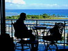 Backlit Scrabble game with a view (peggyhr) Tags: peggyhr silhouettes marina boats island sky pacificocean balcony chairs table game scrabble green blue white black trees clouds dsc06496ab hawaii