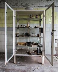 Medicine Cabinet in Pripyat Hospital - Chernobyl (Craig Hannah) Tags: pripyat chernobylnuclearpowerstation chernobyl zoneofalienation abandoned derelict decay derelectbuilding radioactivecontamination 30kilometrezone exclusionzone disaster accident nucleardisaster craighannah 2017 september ukraine hospital medecine drugs cabinate ghosttown