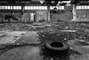 (see it, shoot it) Tags: 2016 birkenhead wirral derelict tyre disused factory abandoned graffiti sony a6000 1635mm zeiss bw
