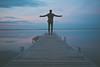 Jumping (thannusan.sivabaskaran) Tags: stones beach chillin photoshoot jumping