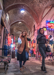 Grand Bazaar, Isfahan, Iran (Feng Wei Photography) Tags: retail middleeast isfahan bazaar shopping persian middleeasternculture vertical colorimage grandbazaar street indoors famousplace fashion iran iranianculture travel woman traditionalclothing traveldestinations persianculture market religiousdress tourism landmark business irn girl girls