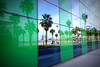 Through the mirror (Fnikos) Tags: street road park parc parco beach shore seashore sand coast sky cloud sea water waterfront city building tower architecture mirror reflection tree palmtree grass nature outdoor