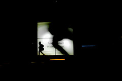 Layer of silhouttes (A. Yousuf Kurniawan) Tags: shadow night nightphotography light lamp box walk walkway street streetphotography decisivemoment cameraphone cameraphonestreet colourstreetphotography red dark minimalism minimalist cyclist silhouette juxtaposition
