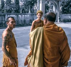 Monks three. (dusk_rider) Tags: monk buddha buddhist thailand canon powershot a560 2009 february orange religious tattoo sak yant