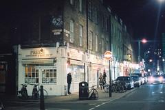 Brick Lane (goodfella2459) Tags: nikon f4 af nikkor 50mm f14d lens cinestill 800t 35mm c41 film brick lane night hanbury street east end london road cars lights city whitechapel