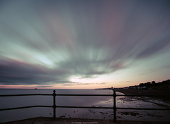 ===I===I=== (Kevin HARWIN) Tags: water sea wet stones metal long exposure colours clouds moveing sky pier canon eos m3 sigma 1020mm lens herne bay hampton kent south east uk england britain fence green red pink blue