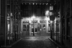 New York City | Mill Lane 01 (Christopher James Botham) Tags: nyc newyork newyorkcity manhattan lowermanhattan lane street streetscape city cityscape urban architecture building bar tavern storefront scaffold scaffolding night lowlight outdoor stonestreet stone cobblestone milllane mill