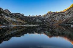 Lake Sabrina Sunrise (RStonejr) Tags: inyocounty inyo flickr ybs2017 lake picture sabrina lakesabrina sunrise nature light water landscape sun tree trees me new texture blue fall yellow fallcolors sierranevada easternsierra sierranevadamountains mountains bishop green river winter reflecting reflection mirror mountain canon 80d canon80d