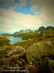 Solbjørnvatnet (liamearth) Tags: earth loch lake shore sky clouds mountain sceneic wilderness beautiful view outdoor water grass western landscape wild lofoten norway arctic circle traveling moskenesøya real life camping rock serene river mountainside reine bay crag snow