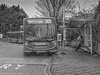 Almost Ready To Go (M C Smith) Tags: station bus busstop busshelter bw pentax k3 monochrome sketch blockpaving kerb pavement buses letters numbers symbols trees bushes poster advertising timetable route 313 arriva lamps sky woman sitting waiting seats steps