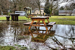 Picnic Anyone? (Geoff Henson) Tags: strontium chemistry science water puddle bench reflection trees grass bus scotland february winter