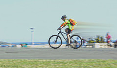 Panning Cyclist (Allan Jones Photographer) Tags: bicycle cyclist helmet shorts speed blur panning slowshutter action motion hoe plymouthhoe sea allanjonesphotographer canon5d3 canonef24105mmf4lisusm street outdoors