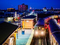 D Train at Coney Island (deepaqua) Tags: brooklyn night skyscraper offseason winter coneyisland skyline bluehour financialdistrict oneworldtradecenter subway subwaystation downtown