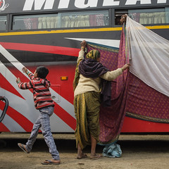 Bus stand (SaumalyaGhosh.com) Tags: bus people color india kolkata hands boy play work street streetphotography