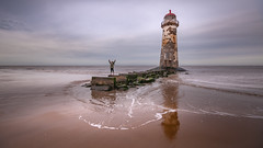 Good times (Einir Wyn Leigh) Tags: seascape fun walking beach lighthouse wales cymru reflection light water sea ocean sand sky outside pleasure colorful old child coast