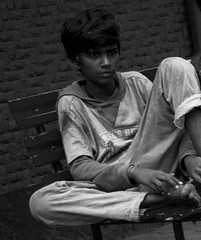 Solitude (magiceye) Tags: boy sitting thinking streetportrait street streetphoto mumbai india monochrome blackandwhite bnw