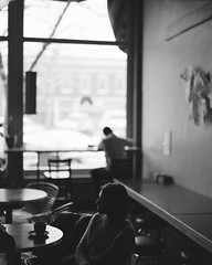 Coffee conversations by darylovejr - Candid photo inside Bean Cycle. I seriously spend a lot of time in this place.   Pentax 67 - 105mm 2.4 - Kodak Portra 160 converted to B&W